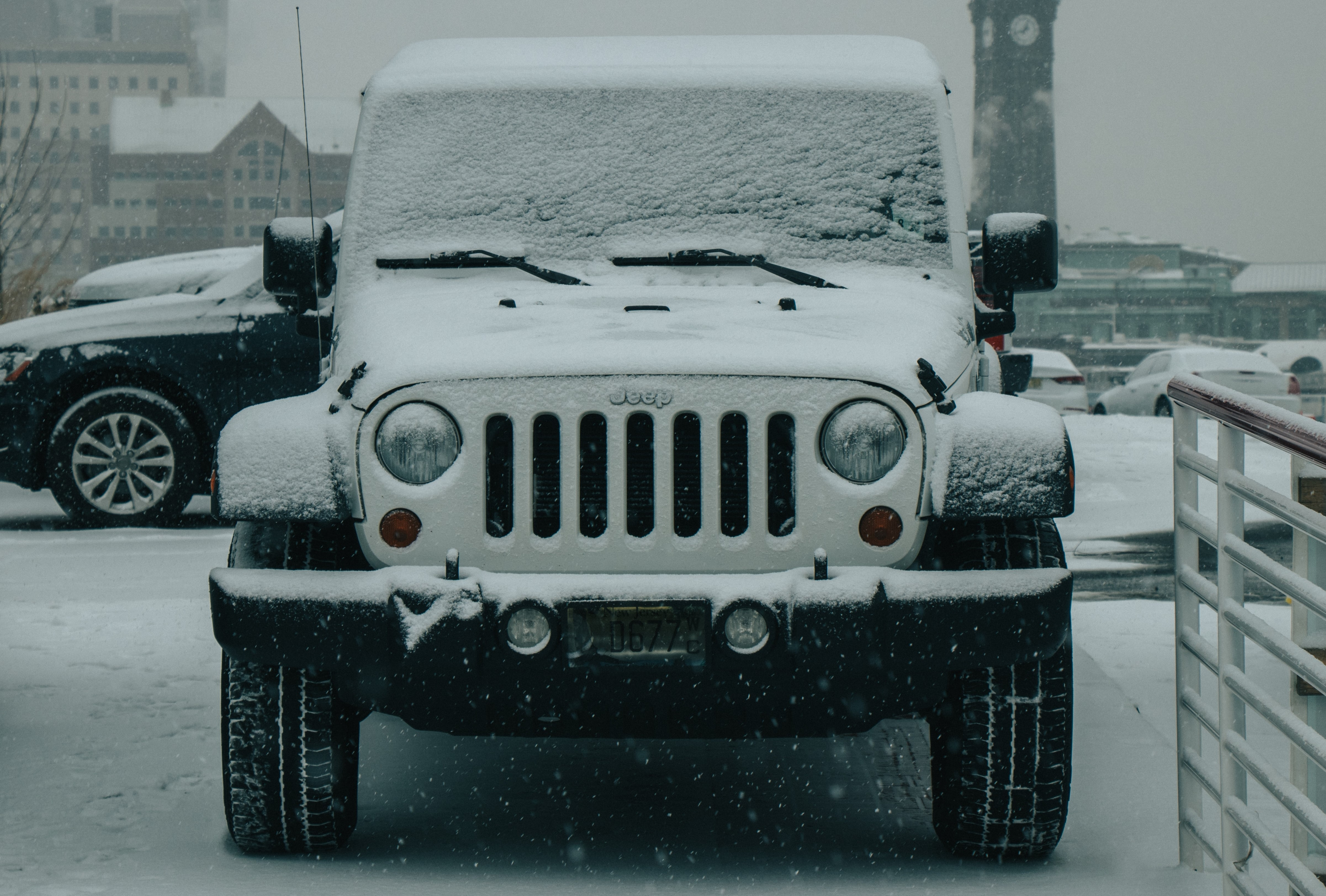 jeep covered in the snow in winter time